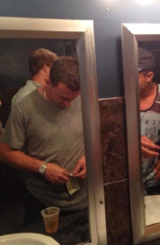 Johnny Manziel rolling bill bathroom money